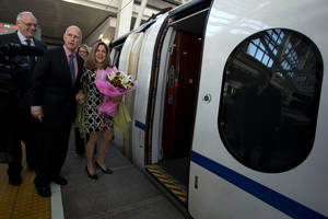 Photo - California Gov. Jerry Brown, center left, and his wife Anne Brown, center, prepare to board a high speed rail leaving from the Beijing South train station in Beijing, China, Thursday, April 11, 2013. Brown highlighted his state's interest in infrastructure by traveling on China's high-speed rail system, which is the longest in the world.   (AP Photo/Ng Han Guan)
