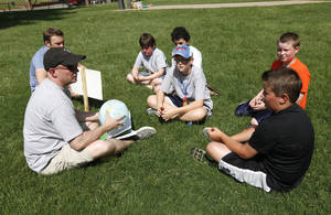 Photo - Lon Fett teaches one of the 2013 vacation Bible school gatherings hosted by First Baptist Church of Edmond at Spring Hill Park in Edmond. <cutline_credit_leadin>Photo by Paul Hellstern, The Oklahoman Archives</cutline_credit_leadin> <strong>PAUL HELLSTERN</strong>
