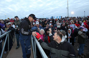 Photo - Oklahoma pro bass angler Edwin Evers signs an autograph at the start of last year's Bassmaster Classic on the Red River in Bossier City, La. Evers is one of three Oklahoma pros who qualified for the 2013 Bassmaster Classic next month on Grand Lake. Tommy Biffle of Wagoner and Jason Christie of Park Hill also will be fishing in the tournament which will award $500,000 to the winner. AP ARCHIVE PHOTO