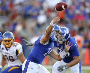 Photo -   Kansas quarterback Dayne Crist (10) throws a pass against the South Dakota State in the first quarter of an NCAA college football game Saturday, Sept. 1, 2012, in Lawrence, Kan. (AP Photo/Ed Zurga)