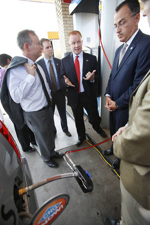 Photo - Mayor Mick Cornett, Rep. Randy Grau, Scott Minton, Rep. Randy McDaniel and Clark Jolley at Love's opening of its first CNG fueling stations at I-35 and NE 122, in Oklahoma City , Friday, July 13 , 2012. Photo By David McDaniel/The Oklahoman