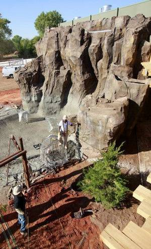 Photo - A 30-foot waterfall will be one of the key features in the large elephant yard in the new exhibiat the Oklahoma City Zoo. The waterfall leads into a pool that holds 214,000 gallons of water. <strong>PAUL B. SOUTHERLAND - THE OKLAHOMAN</strong>