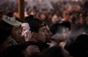 photo - Egyptians attend a demonstration in Tahrir Square, Cairo, Egypt, Friday, Nov. 30, 2012. Liberal and secular parties held major protests against Egyptian President Mohammed Morsi's latest decrees granting himself almost complete powers. (AP Photo/Nariman El-Mofty)