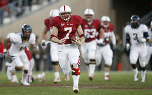 photo - Stanford running back Toby Gerhart has rushed for 1,736  yards and 26 TDs and is a Heisman Trophy finalist. AP PHOTO