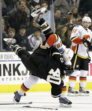 photo - Dallas Stars center Ryan Garbutt (40) is flipped by Calgary Flames' Steve Begin (25) during a fight in the first period of an NHL hockey game Sunday, Feb. 17, 2013, in Dallas. (AP Photo/Tony Gutierrez)