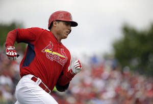Photo - St. Louis Cardinals' Aledmys Diaz hits a single   in the fourth inning of an exhibition spring training baseball game against the Washington Nationals, Friday, March 21, 2014, in Jupiter, Fla. (AP Photo/David Goldman)