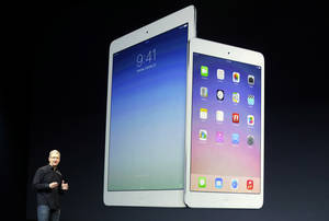 Photo - Apple CEO Tim Cook introduces the new iPad Air in October 2013. (AP Photo/Marcio Jose Sanchez) <strong>Marcio Jose Sanchez</strong>