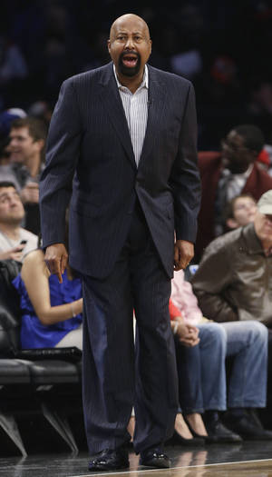 Photo - New York Knicks coach Mike Woodson calls out to his team during the first half of an NBA basketball game against the Brooklyn Nets on Tuesday, April 15, 2014, in New York. (AP Photo/Frank Franklin II)
