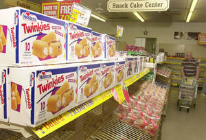 photo - Twinkies await sale on a shelf in a Wonder Bread Outlet store Tuesday, Aug. 19, 2003, in Lawrence, Kan.  More than 70 years after the debut of the world famous Hostess Twinkie, the current baker of the treats is struggling as competitors including Krispy Kreme Doughnuts Inc. eat away  at the baked goods industry profits. (AP Photo/Orlin Wagner)