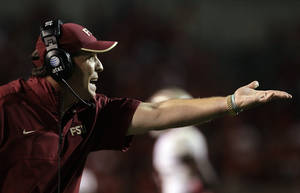 photo -   Florida State coach Jimbo Fisher gestures during the second half of an NCAA college football game against North Carolina State in Raleigh, N.C., Saturday, Oct. 6, 2012. North Carolina State won 17-16. (AP Photo/Gerry Broome)