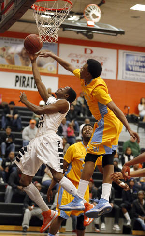Photo - Putnam City's Wylie Walton shoots a lay up as Putnam City West's Tyson Jolly defends  during the high school basketball game between Putnam City and Putnam City West at Putnam City High School,  Saturday, Feb. 23, 2013. Photo by Sarah Phipps, The Oklahoman