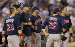 Photo - Cleveland Indians manager Terry Francona, third from left, stands on the mound with his team during a pitching change in the eighth inning of a baseball game against the Kansas City Royals, Wednesday, Sept. 18, 2013, in Kansas City, Mo. Kansas City won the game 7-2. (AP Photo/Charlie Riedel)
