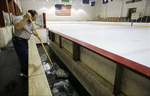 Photo -   Tim Wilson cleans around a vacant Nashville Predators practice rink on Monday, Sept. 17, 2012, in Nashville, Tenn. The NHL locked out its players at midnight Saturday, the fourth shutdown for the NHL since 1992. (AP Photo/Mark Humphrey)