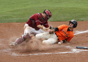 photo - OU / OSU / BEDLAM COLLEGE BASEBALL: Oklahoma State's Robbie Rea scores the winning run as Oklahoma's Dylan Neal drops the ball during the Bedlam baseball game between the University of Oklahoma and Oklahoma State University at the Chickasaw Bricktown Ballpark in Oklahoma City, Sunday, May 6, 2012. Photo by Sarah Phipps, The Oklahoman