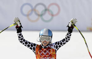 Photo - Argentina's Macarena Simari Birkner gestures from the finish area at the end of the downhill portion of the women's supercombined at the Sochi 2014 Winter Olympics, Monday, Feb. 10, 2014, in Krasnaya Polyana, Russia. (AP Photo/Gero Breloer)