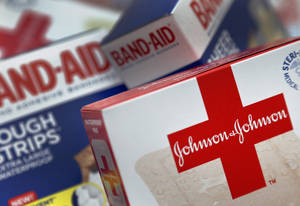 Photo - This Oct. 16 2012 photo shows Johnson and Johnson products, including Band Aid brand adhesive bandages, arranged for a photo in St. Petersburg, Fla. Johnson & Johnson reports quarterly financial results before the market opens on Tuesday, April 15, 2014. (AP Photo/Chris O'Meara)