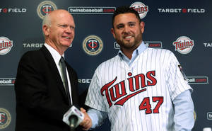 Photo - Minnesota Twins general manager Terry Ryan shakes hands with pitcher Ricky Nolasco  during a press conference at Target Field in Minneapolis Tuesday, Dec. 3, 2013. The Minnesota Twins announced Tuesday they  finalized a $49 million, four-year contract with right-hander  Nolasco.  (AP Photo/The Star Tribune, Kyndell Harkness)  MANDATORY CREDIT; ST. PAUL PIONEER PRESS OUT; MAGS OUT; TWIN CITIES TV OUT