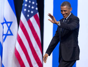 photo - President Barack Obama waves to the audience as he arrives to speak at the International Convention Center in Jerusalem, Thursday, March 21, 2013. (AP Photo/Carolyn Kaster)