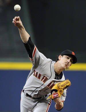 Photo - San Francisco Giants starting pitcher Tim Lincecum delivers to the Atlanta Braves during the first inning of a baseball game Friday, May 2, 2014, in Atlanta. (AP Photo/David Tulis)