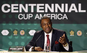 "Photo - FILE - A Thursday, May 1, 2014 photo from files showing Jeffrey Webb, FIFA Vice President, gesturing as he speaks during a news conference in Bal Harbour, Fla. Webb condemned ""deep rooted racism"" in Italy on Wednesday, May 21, 2014, after Mario Balotelli was racially abused while training with the national team. A year after spearheading the strengthening of FIFA's discrimination sanctions, Webb is frustrated that some countries including Italy and Spain are not showing the commitment required to the fight against racism. (AP Photo/Alan Diaz, File)"