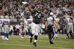 Photo - Philadelphia Eagles defensive end Cedric Thornton (72) celebrates after cornerback Brandon Boykin intercepted the ball from Dallas Cowboys quarterback Kyle Orton during the second half of an NFL football game, Sunday, Dec. 29, 2013, in Arlington, Texas. (AP Photo/Tony Gutierrez)