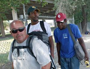"Photo - Antwone Taulton, center, walks with Terry Potts, left, and Ralph ""Scooby"" Crumble, two of the subjects in his new documentary film, in downtown Oklahoma City. PHOTO BY JOHN CLANTON, THE OKLAHOMAN <strong>JOHN CLANTON - JOHN CLANTON</strong>"