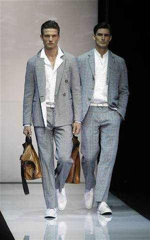 Photo - Models wear creations of Giorgio Armani, from the men's Spring-Summer 2013 collection, part of the Milan Fashion Week, unveiled in Milan, Italy, Tuesday, June 26, 2012. (AP Photo/Luca Bruno)