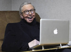 Photo - FILE - In this Jan. 12, 2011 file photo, Pulitzer Prize-winning movie critic Roger Ebert works in his office at the WTTW-TV studios in Chicago. Ebert, who worked at the Chicago Sun-Times for more than 40 years, took first place for online columns or blogs on large websites in the NSNC's annual column contest. (AP Photo/Charles Rex Arbogast, File)