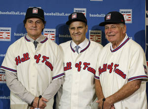 Photo - Retired managers, from left, Tony La Russa, Joe Torre and Bobby Cox gather for a photo after it was announced that they were unanimously elected to the baseball Hall of Fame, at a news conference during MLB winter meetings in Lake Buena Vista, Fla., Monday, Dec. 9, 2013. (AP Photo/John Raoux)