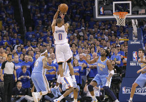 Photo - Oklahoma City's Russell Westbrook (0) puts up the shot that put the Thunder up for good over Denver during the first round NBA playoff game between the Oklahoma City Thunder and the Denver Nuggets on Sunday, April 17, 2011, in Oklahoma City, Okla. Photo by Chris Landsberger, The Oklahoman