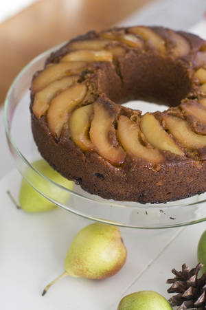 Photo -  A lemon pear upside-down gingerbread cake is shown on a cake stand. AP Photo/Matthew Mead <strong>Matthew Mead - AP</strong>
