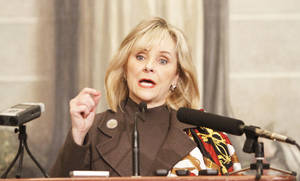 photo - Gov. Mary Fallin talks with reporters during a legislative forum at the state Capitol in Oklahoma City. Photo By Steve Gooch, The Oklahoman Archives