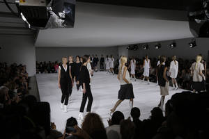 photo -   Models wear creations part of the Jil Sander women's Spring-Summer 2013 collection that was presented in Milan, Italy, Saturday, Sept. 22, 2012. (AP Photo/Luca Bruno)