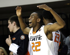 Photo - Oklahoma State's Markel Brown (22) celebrates during the between Oklahoma State University and Utah Valley at Gallagher-Iba Arena in Stillwater, Okla., Tuesday, Nov. 12, 2013. Photo by Sarah Phipps, The Oklahoman