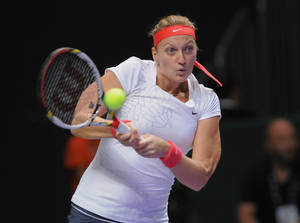 Photo -   Petra Kvitova of Czech Republic returns a shot to Agnieszka Radwanska of Poland during their tennis match at the WTA championship in Istanbul, Turkey, Tuesday, Oct. 23, 2012. (AP Photo)