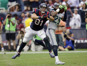 Photo - Seattle Seahawks' Richard Sherman (25) intercepts the ball in front of Houston Texans' Owen Daniels (81) during the fourth quarter an NFL football game on Sunday, Sept. 29, 2013, in Houston. Sherman returned the ball for a touchdown. (AP Photo/Patric Schneider)