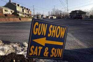 photo - A sign is posted for an upcoming gun show, Friday, Jan. 4, 2013, in Leesport, Pa. Gun advocates arenít backing down from their insistence on the right to keep and bear arms. But heightened sensitivities and raw nerves since the Newtown, Conn. shooting are softening displays at gun shows and even leading officials and sponsors to cancel the popular exhibitions altogether. (AP Photo/Matt Rourke)