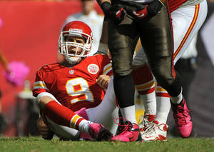 Photo -   Kansas City Chiefs quarterback Brady Quinn (9) gets up after he was sacked by the Tampa Bay Buccaneers defense during the second half of an NFL football game, Sunday, Oct. 14, 2012, in Tampa, Fla. Tampa Bay won 38-10.(AP Photo/Brian Blanco)