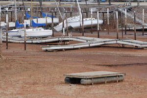 Photo - Boats at the Oklahoma City Yacht Club sit on dry land as the water level at Lake Hefner in Oklahoma City, OK, continues to drop, Tuesday, January 8, 2013,  By Paul Hellstern, The Oklahoman