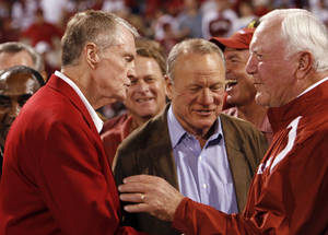 photo - Tom Osborne, Barry Switzer and Chuck Fairbanks (right) shake hands during the halftime ceremonies of the college football game between the University of Oklahoma Sooners and the University of Nebraska Huskers at Oklahoma Memorial Stadium on Saturday, Nov. 1, 2008, in Norman. BY STEVE SISNEY, THE OKLAHOMAN
