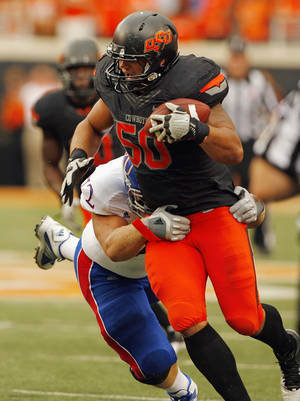 photo - Oklahoma State's Jamie Blatnick (50) intercepts a pas during the second paeriod of a college football game between the Oklahoma State University Cowboys (OSU) and the University of Kansas Jayhawks (KU) at Boone Pickens Stadium in Stillwater, Okla., Saturday, Oct. 8, 2011 Photo by Steve Sisney, The Oklahoman