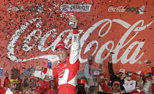 Photo - Kevin Harvick celebrates in victory lane after winning the NASCAR Sprint Cup series Coca-Cola 600 auto race at Charlotte Motor Speedway in Concord, N.C., Sunday, May 26, 2013. (AP Photo/Chuck Burton)