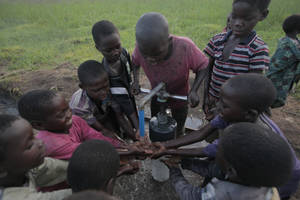 Photo - African youths obtain water provided through a Water4 Foundation project. Photo provided <strong></strong>