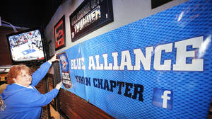 Photo - Lisa Warren prepares for a Blue Alliance watch party for her Yukon chapter.   Photo By David McDaniel, The Oklahoman