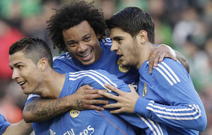 Photo - Real Madrid's Cristiano Ronaldo, left, celebrates with teammate Alvaro Morata, right, and Marcelo Vieira, centre, after scoring against Betis during their La Liga soccer match at the Benito Villamarin stadium, in Seville, Spain on Saturday, Jan. 18, 2014. (AP Photo/Angel Fernandez)