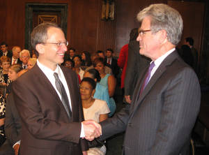 photo - U.S. Magistrate Judge Robert E. Bacharach, left, greets U.S. Sen. Tom Coburn at a May 9 hearing in Washington on Bacharach's nomination to a federal appeals court. <strong>Chris Casteel - The Oklahoman</strong>