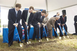 Photo - From left, Thunder coach Scott Brooks, Thunder general manager Sam Presti, Thunder chairman Clay Bennett, Oklahoma City Mayor Mick Cornett, Integris Health CEO and President Stanley Hupfield, City Councilman Patrick Ryan (Ward 8) and City Councilman Skip Kelly (Ward 7) dig their shovels during the groundbreaking ceremony for the Thunder practice facility Thursday. PHOTO PROVIDED