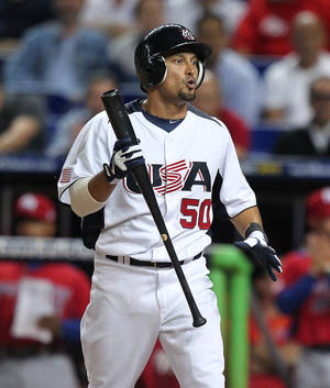 Photo - USA Shane Victorino reacts after striking out during the ninth inning of the World Baseball Classic second round Pool 2 elimination game between Puerto Rico and the United States at Marlins Park in Miami on Friday, March 15, 2013. Puerto Rico defeated the U.S. 4-3.  (AP Photo/The Miami Herald, David Santiago)  MAGS OUT