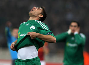 Photo -   FILE This Thursday, Feb. 18, 2010 file photo shows Panathinaikos' Costas Katsouranis reacting during a soccer match of the Europa League against Roma at the Olympic stadium of Athens. Panathinaikos has kicked captain Costas Katsouranis off the team after the Athens club won only one of its five league matches this season. The club announced its decision Wednesday Oct. 3, 2012 after a morning training session ahead of a Europa League match against Tottenham on Thursday.(AP Photo/Thanassis Stavrakis, File)