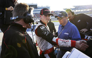 Photo - Ryan Blaney, center, celebrates with crew members after qualifying for the NASCAR Nationwide series auto race, Saturday, May 17, 2014, at Iowa Speedway in Newton, Iowa. Blaney won the pole position for Sunday's race. (AP Photo/Charlie Neibergall)